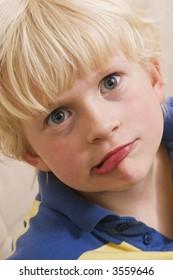 Little boy making grimace (funny face)