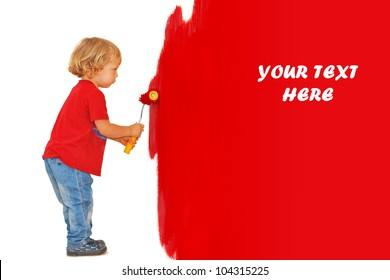 Little boy making renovation, painting the wall in red color (isolated over the white, with place for your text/design)