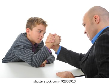 little boy and a man businessman arm wrestling. Isolated on white background
