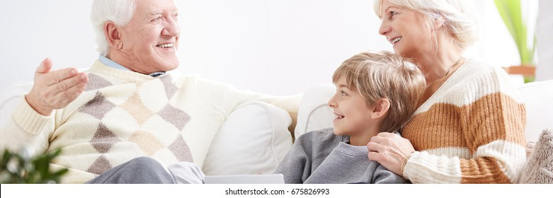 Little boy meeting grandparents in their living room