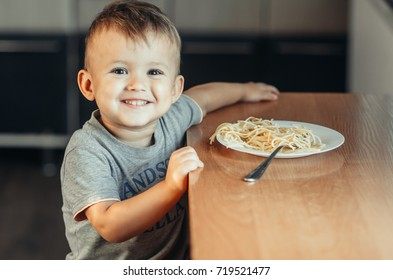 little boy with mom in the kitchen preparing flour from those of the test dish, dumplings