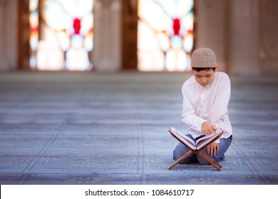 little boy in the mosque read the Quran