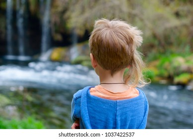 little boy near waterfalls