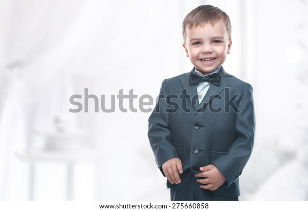 Little boy in a nice suit and glasses. Back to school. Children portrait. Stylish man in fashionable suit