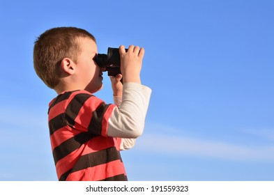 Little boy observing surroundings in midday