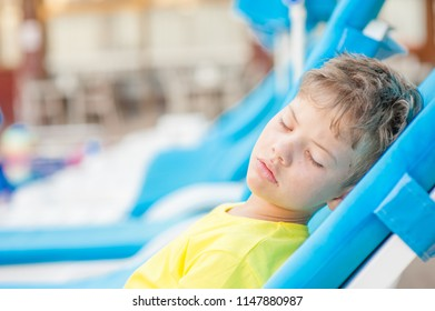 Little boy on the beach with a sunstroke. Space for text