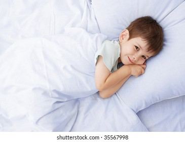 The little boy on a bed