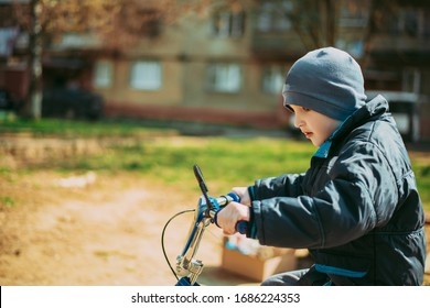 little boy on bicycle in the park
