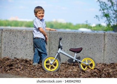 Little boy on a bicycle in the summer park