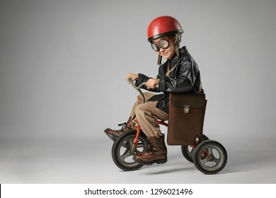 Little boy on a bike imagines himself a racer
