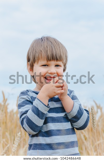 Little boy on the field with ears
