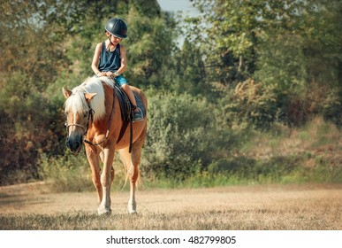 Little boy on the horse.