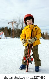 the little boy on the mountains with ski