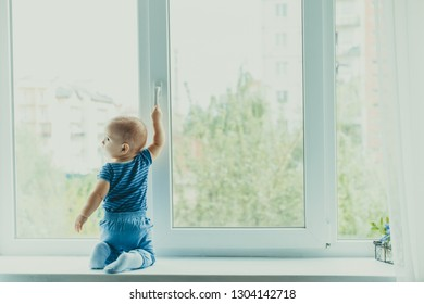 Little boy on the windowsill, danger in the home