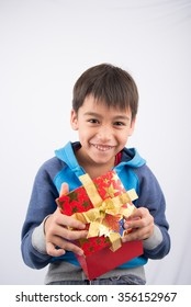 Little boy opening gift present box on white background