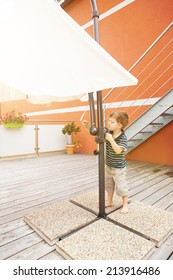 Little boy opens the parasol