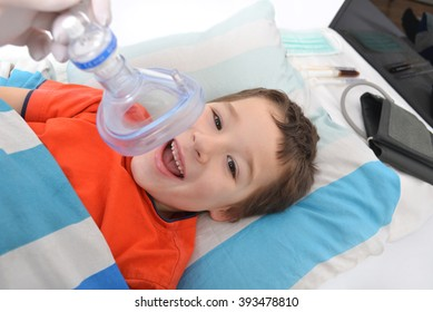 little boy with an oxygen mask in hospital