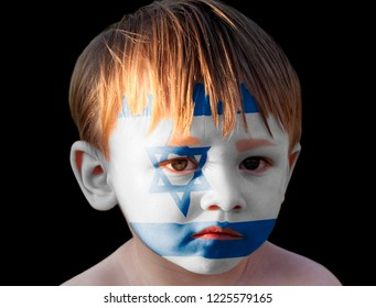 Little boy with painted Flag of Israel isolated on black background