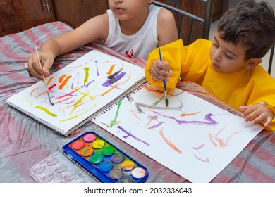 little boy painting with colorful paints with his brush. children's creativity and development concept
