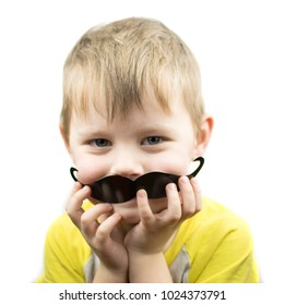 little boy with a paper mustache, isolated