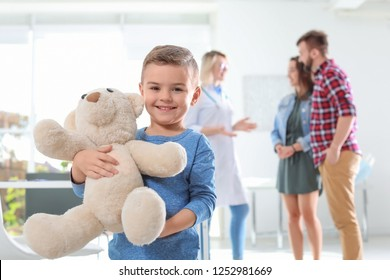 Little boy with parents visiting children's doctor in hospital
