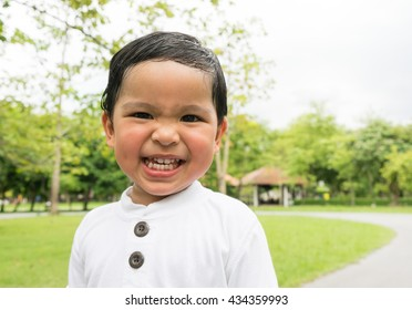 Little Boy in a park or garden among trees