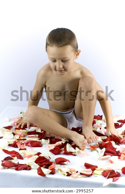 little boy with petals in spa