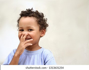Little boy picking his nose and having fun