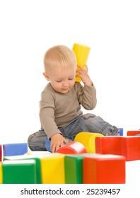 little boy play with bricks. isolated on a white background