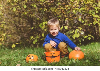 little boy play with halloween toys in autumn, kids trick or treating