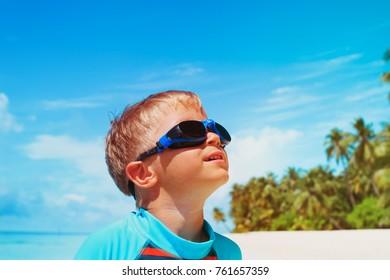 little boy play have fun on tropical beach
