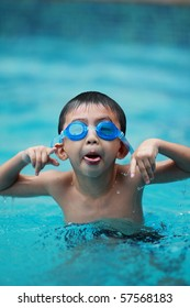 little boy play in the pool