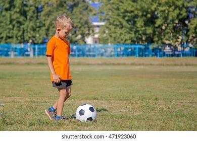 little boy play soccer