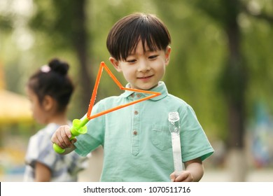 The little boy played bubble water