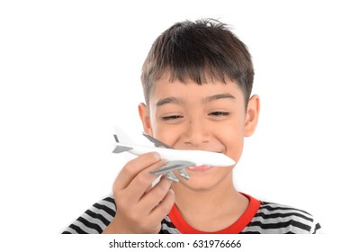 Little boy playing airplane model, isolate on white background