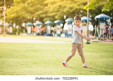 Little boy playing ball in the park