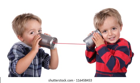 Little boy playing with can phone connected by string, concept for talking to yourself
