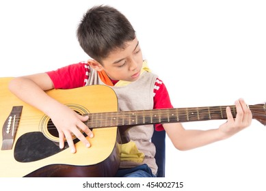 Little boy playing classic guitar on white background