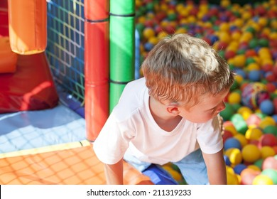 Little boy playing in colorful balls park playground