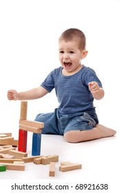 little boy playing with colorful blocks