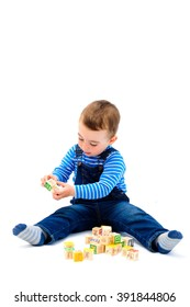 Little boy playing with educational toys over white background