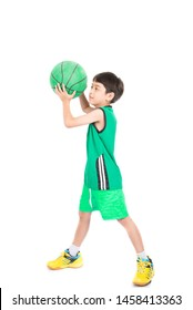 Little boy playing green basketball in green uniform sport on white background