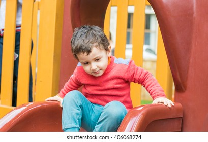 little boy playing on the Playground in the spring