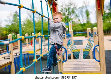 Little boy playing on the playground.
