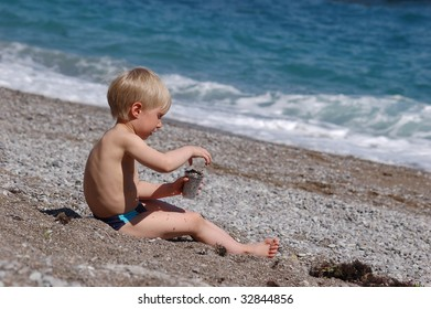 little boy playing on the seashore