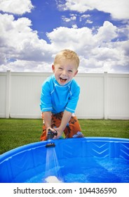 Little Boy playing outside in the Summer Sun
