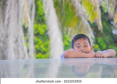 Little boy playing peekaboo peek-a-boo game
