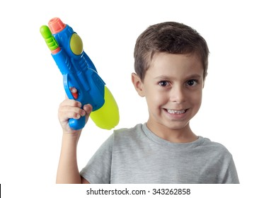 Little boy playing with plastic water gun isolated on white.