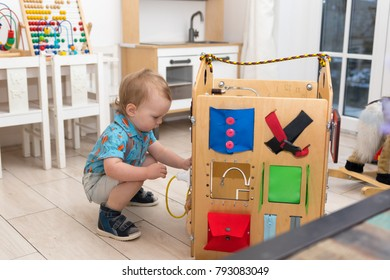 A little boy is playing in the playroom of the kindergarten