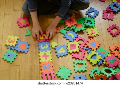 little boy playing with puzzle, education